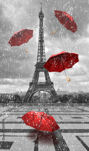 Eiffel tower with flying umbrellas.