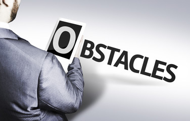 Business man with the text Obstacles in a concept image