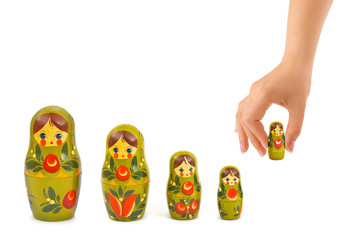 Hand and russian toy matrioska