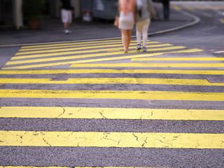 padestrian street crossing on yellow zebra line