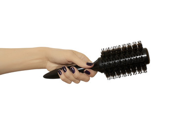 Round hair brush in hand
