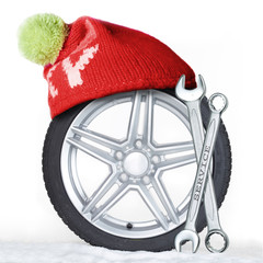 Winter tire with bobble hat and jaw spanner