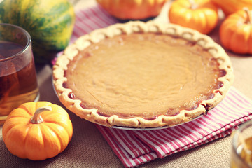 Pumpkin pie with small pumpkins