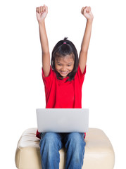 Young Asian girl with a laptop raising her arms