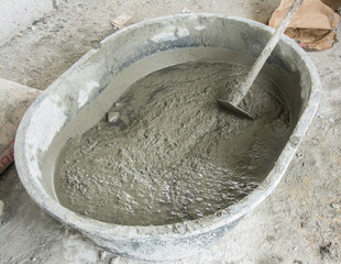 Mixing a cement in salver for applying construction