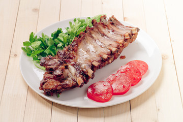 Plate with roasted pork ribs