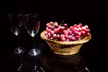 Glasses with wine and grapes