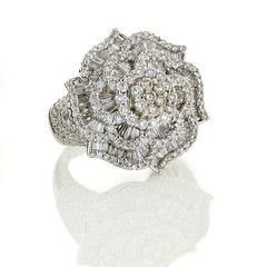 Ring with precious stones.
