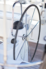 a modern sailing yacht steering wheels