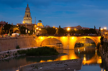 Old bridge over Segura river in night