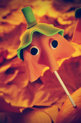 homemade cake pop with the shape of a ghost Halloween pumpkin, w