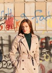 portrait of young beautiful woman girl on graffiti brick wall ba