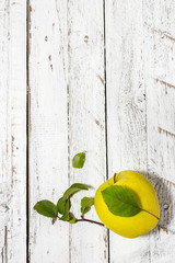 Apple on the wooden light background