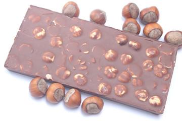 Chocolate bar with hazelnuts on white background
