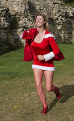 Female Santa running with sack of Christmas presents