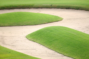 Sand bunker on golf field