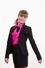 Portrait of young slim girl in a suit