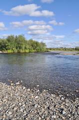 Pebble riverbanks.
