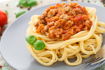 Spaghetti bolognese with basil leave