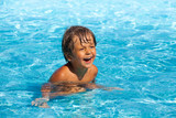 Laughing boy with positive emotions swim in pool poster