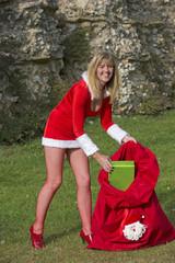 Santa's helper with sack delivering Xmas presents