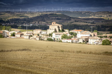 Spanish landscape with an ancient village and wind generators