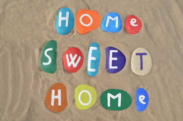 Home sweet home concept on colored stones