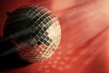 Disco ball on red background