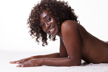 Smiling Black Woman Topless Reclining Breast Covered