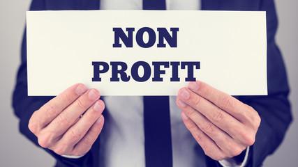 Businessman Holding Non Profit Signage