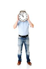Businessman wearing helmet with clock