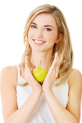 Woman with a green apple