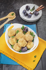 Plum dumplings covered with breadcrumb and sprinkled with sugar