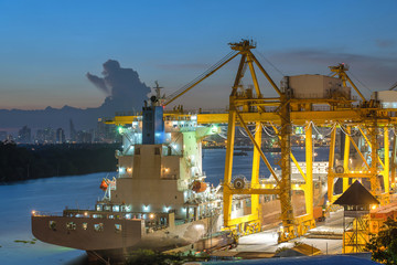 Industrial Container Cargo freight ship with working crane bridg