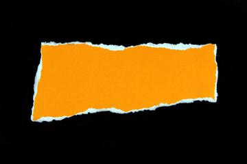 orange torn paper on black background