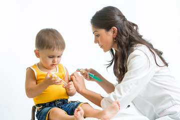 doctor injecting baby