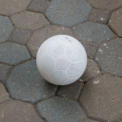 Football on the footpath.