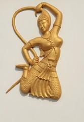 deva statue on the white wall