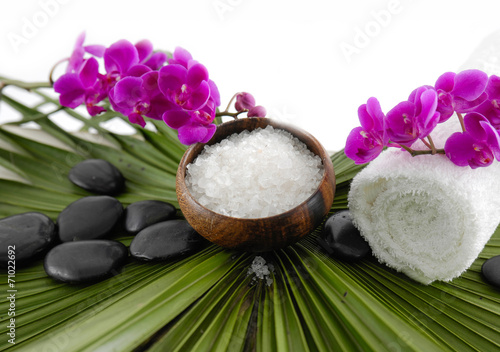 Poster Spa orchid and roller white towel on ,stones on green palm
