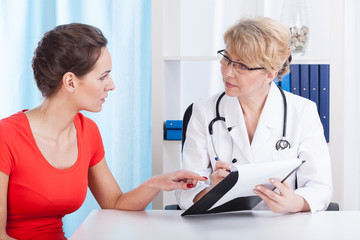 Doctor talking with patient about recommendations
