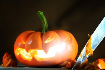 Carving a Halloween jack o' lantern