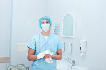 Surgeon preparing hands for surgery . surgeon doctor wipes his h