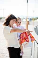 Mother with baby with shopping bags