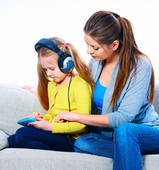 Girl listening lesson with tablet pc and headphones