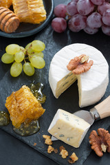 delicious Camembert with fresh honey and nuts, top view