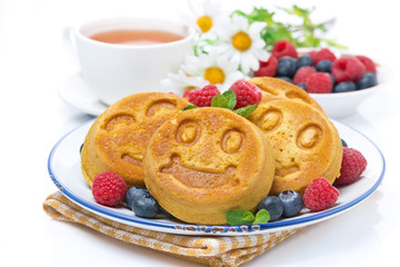 delicious corn pancake with berries, tea and honey for breakfast