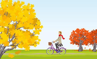 Women cycling in Autumn