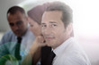Portrait of confident businessman attending meeting
