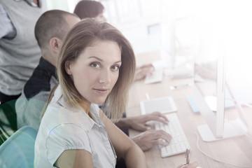 Portrait of businesswoman attending training course