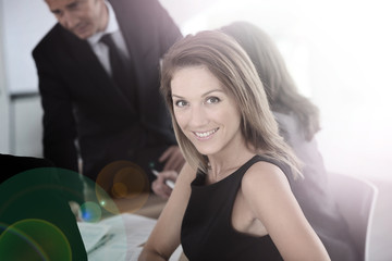 Smiling attractive businesswoman attending meeting